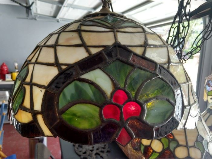 Evidence of a change in lighting decor - this is one of four stained glass chandelier's available.