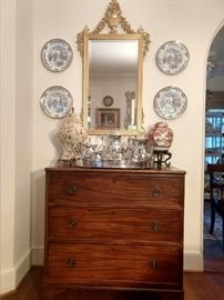 Antique 3-drawer English mahogany chest, from Joseph Konrad Antiques.                                                                              Nice, vintage LaBarge gold gilt Italian mirror above a silverplated gallery tray and tea set.