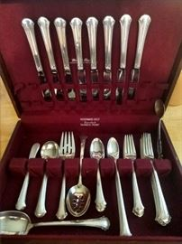 """51-piece set of sterling flatware, """"Chippendale"""", by Towle."""