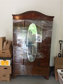 Antique inland armoire with mirror