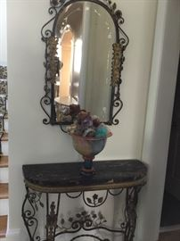 Wrought iron mirror and marble top entry table.