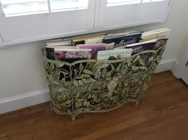 Classic wrought iron planter used as a magazine rack.  Great idea.
