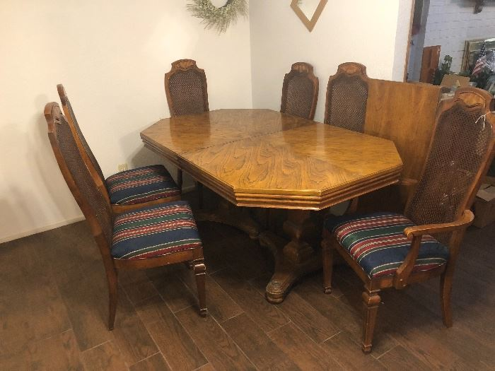 Dining room table with four chairs and two armchairs