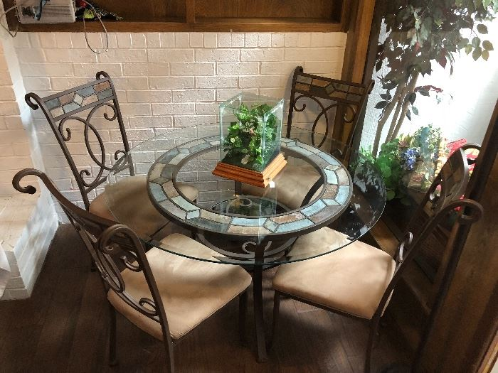 Beautiful glass top with iron chairs