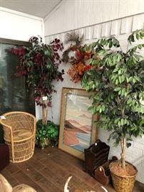 magazine racks, beautiful print artwork, bamboo chair, décor trees