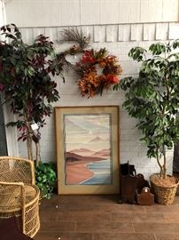 Wall art, artificial trees, wicker chair