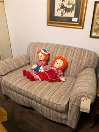 loveseat with raggedy Ann and Andy