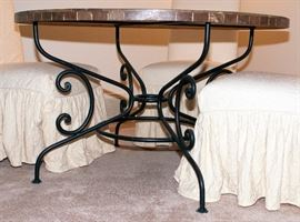 """Arhaus marble table top with cast iron legs with four covered chairs - 48"""" Diameter x 30"""" Height. Cast iron leg detail."""