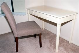 """White painted table with chair. Table - 43.5"""" Length x 22"""" Width x 20"""" Depth. Chair - 55.5"""" Height x 20"""" Width."""
