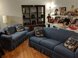 This is a nice sofa and love seat. The sofa is a sleeper that has not been used. The back open display cabinet is 2 pieces and solid wood.
