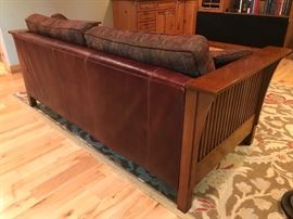 Stickley Sofa.  Description reads Sofa Body, Let and Pillow in Leather Grade 2 Ganache and Back and Seat Cushions in Fabric.