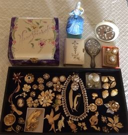 Vintage hankie box, German celluloid prayer book, German figural fragrance bottle (blue lady), Baby Ben alarm clock & lots more costume jewelry, some signed pieces