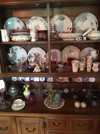 Hutch full of antique glass & china.  Butter pat collection