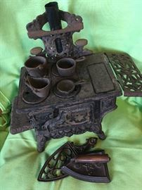 Antique toy stove & iron with trivet