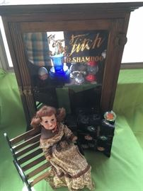 """The Fitch Dr. Shampoo"" antique display cabinet.  Child's glass dishes, candy containers.  A&M antique doll"
