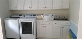 Lovely Brookhaven laundry room cabinetry