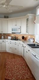 Let's cook up some fun in this beautiful kitchen! Cabinets by Brookhaven.