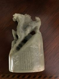 Jade carving of two horses with engraved writing