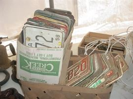 boxes of old auto license plates from the 1940's forward