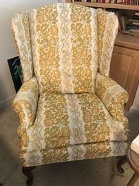 One of 2 wingback chairs