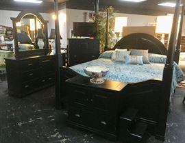 VERY NICE,  5-Piece BLACK WOODEN King Size Bedroom Suit, with 4-poster bed, dresser w/curved top mirror and beveled glass, chest of drawers, night stand, and small step stool.