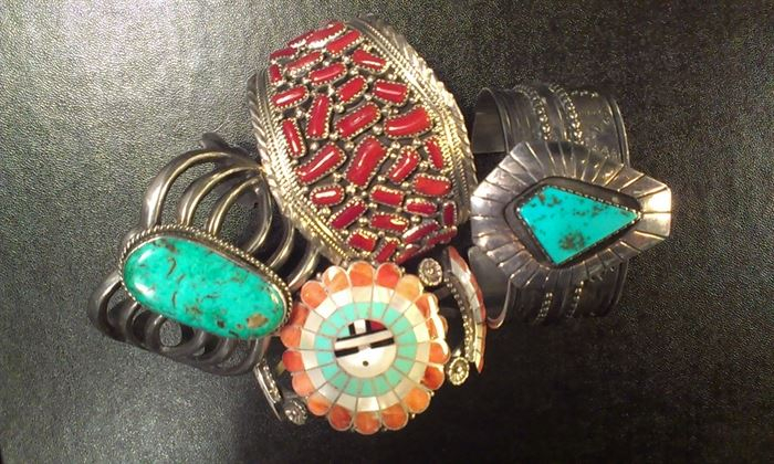 Selection of Navajo sterling cuffs...