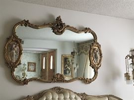 Incredible carved mirror with sculptures