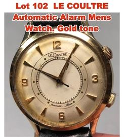 Lot 102 LE COULTRE Automatic Alarm Mens Watch. Gold tone