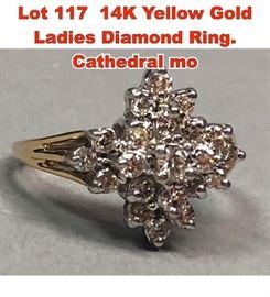 Lot 117 14K Yellow Gold Ladies Diamond Ring. Cathedral mo