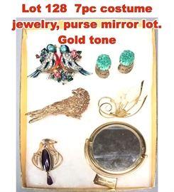 Lot 128 7pc costume jewelry, purse mirror lot. Gold tone