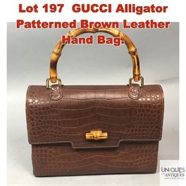 Lot 197 GUCCI Alligator Patterned Brown Leather Hand Bag.