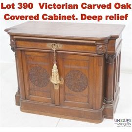 Lot 390 Victorian Carved Oak Covered Cabinet. Deep relief