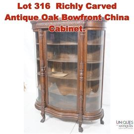Lot 316 Richly Carved Antique Oak Bowfront China Cabinet.