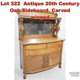 Lot 322 Antique 20th Century Oak Sideboard. Carved winged