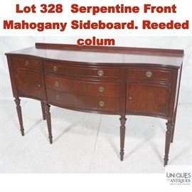 Lot 328 Serpentine Front Mahogany Sideboard. Reeded colum