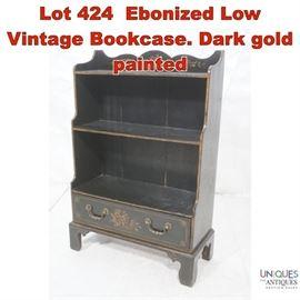Lot 424 Ebonized Low Vintage Bookcase. Dark gold painted