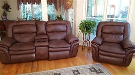 Love seat with cup holder, recliner. This recliner and love seat are electric.
