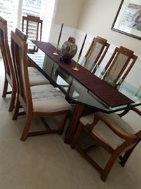 Gorgeous dining room table with glass top