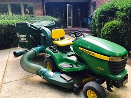 John Deere Riding Lawn Mower with Cyclone Rake for leaf and debris removal
