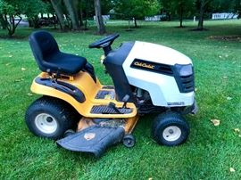 Cub Cadet tractor with pull cart and roller.