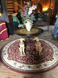Round Rug -Table-Composite Dog Statues- Vase with Silk Flowers