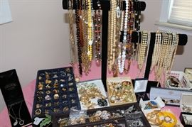 Tons of jewelry including some gold rings and some sterling silver pieces.