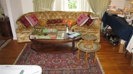 One of 3 Karastan Rugs.  MCM coffee table and brass / teak folding  / stacked table.