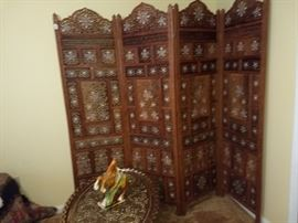 Carved folding screen. Teak wood with inlay.