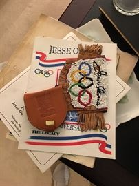 Olympic memorabilia. COA available. Coca Cola endorsed Olympic endorsements. Hand beaded Indian pouch for namesake.