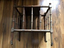 Hollywood Regency style wood rolling magazine rack