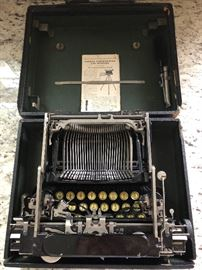 1950's industrial Chair metal Wood 1920's Coat rack .Typewriter:mobile fold up unit 1920's corona typewriter
