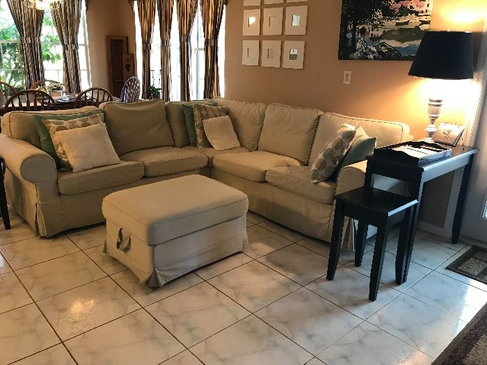 Corner sofa with storage ottoman. Sofa table with two smaller tables that under