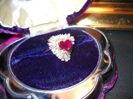 14K gold ring with 2 carat heart-shaped ruby surrounded by diamonds