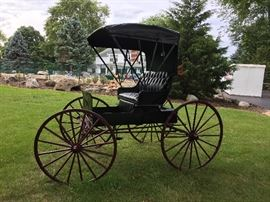 Antique horse drawn buggy with seat for 2